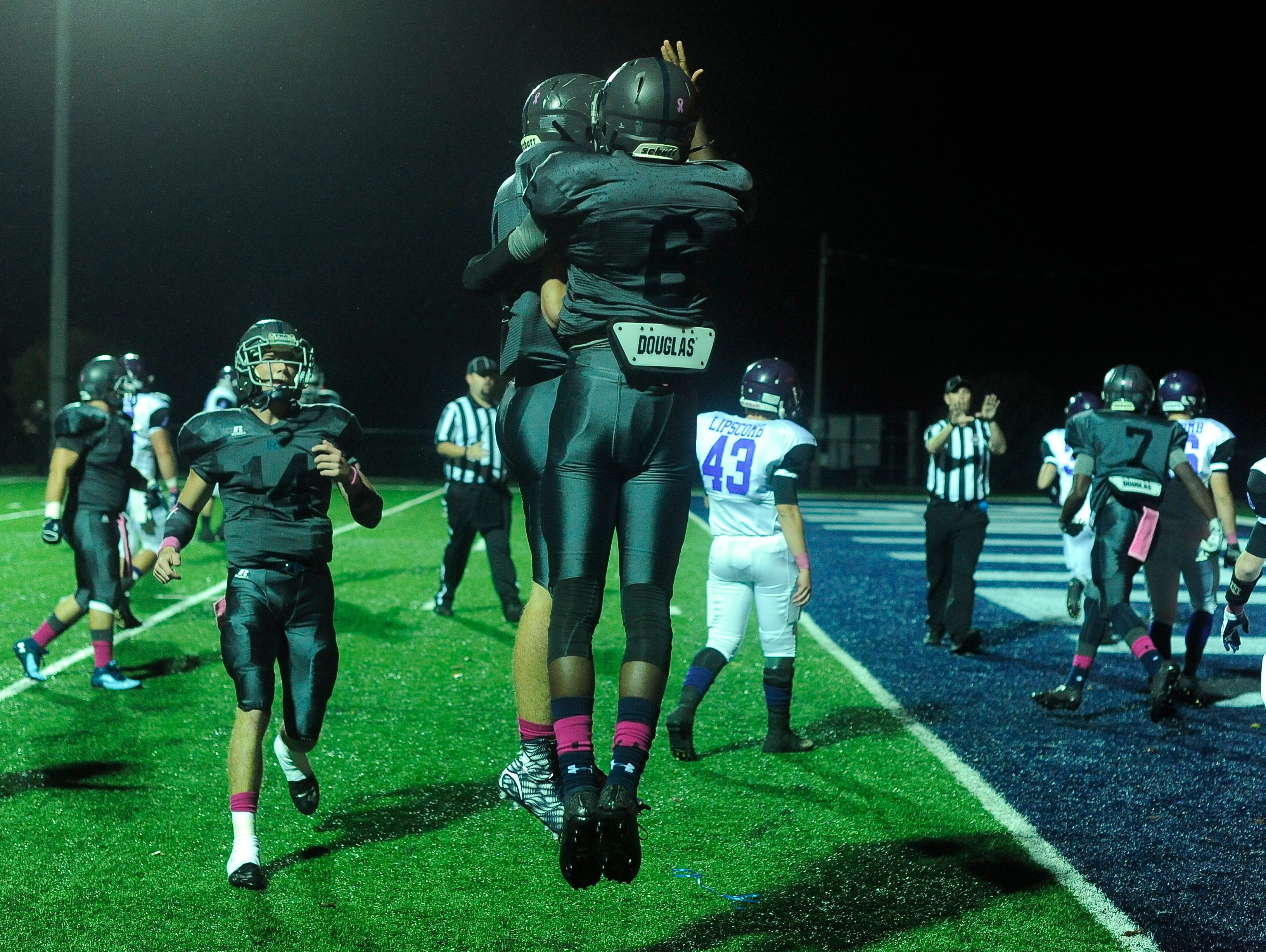 Franklin Road Academy tight end Watson Tansil (1) and wide receiver Lance Wilhoite (6) celebrate their touchdown during the first quarter against Lipscomb Friday.