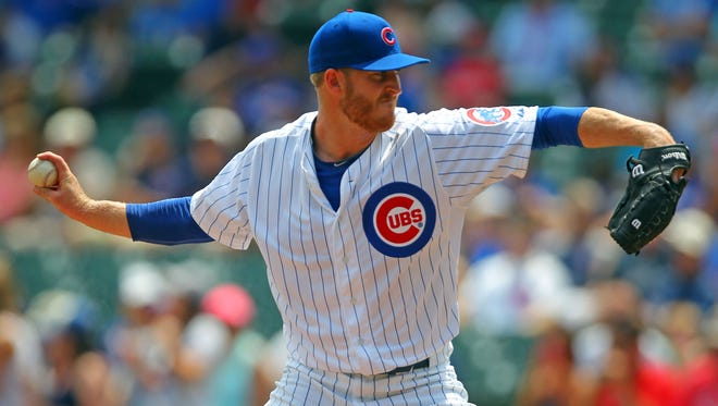 Chicago Cubs starting pitcher Dallas Beeler (32) delivers a pitch during the first inning against the Washington Nationals at Wrigley Field.