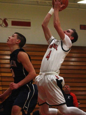 Livonia Churchill's Jon Hovermale elevates for a short jump shot during Friday's victory over Franklin.