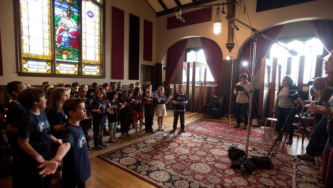 Second-grade students from Claxton Elementary sing a song May 6 at Echo Mountain Recording Studios.