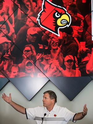 Louisville Athletic Director Tom Jurich reached out his arms to include all the student athletes who will benefit from an announced $160 million contract with Adidas to provide apparel to the school. Aug. 25, 2017.