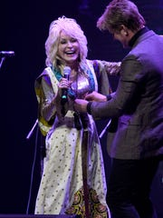 "Dolly Parton jokes with her creative director Steve Summers during a costume change as she helped launch Dollywood's ""Season of Showstoppers"" with a special preview for media and season passholders Friday, Mar. 16, 2018."