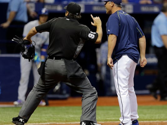 Home plate umpire Mark Ripperger, left, ejects Tampa Bay Rays manager Kevin Cash after Cash was arguing ball and strike calls during the fifth inning of a baseball game against the Toronto Blue Jays, Friday, April 29, 2016, in St. Petersburg, Fla. (AP Photo/Chris O'Meara)