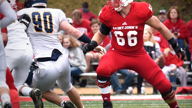 St. John's offensive tackle Noah Voigt concentrates on the play during a game in October 2016 in Collegeville.