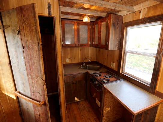 The kitchenette has a counter with a sink along the