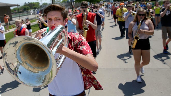 Tom Benthein, a senior with the Appleton East Marching Band, marches down Schaeffer Street while practicing Sunday, May 22, 2016, for the band's performance at the National Memorial Day Parade in Washington, D.C.