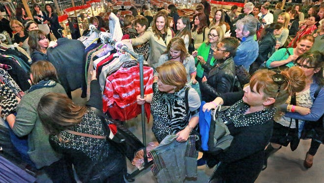 Let the shopping begin! The crowd rushed the dress racks moments after the clock hit 7 p.m. for the Indy 2014 Style Swap at the City Market.