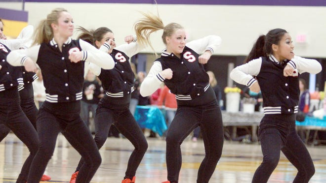 """The Stevens Point Area Senior High Dance Team performs a hip-hop routine in the """"It's Showtime Dance Competition"""" in 2013 at the University of Wisconsin-Stevens Point campus."""
