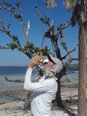 Mark chugs breakfast on Panther Key. Naples father