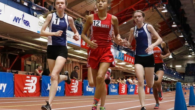 Ursuline's Haley McLean left, and twin sister Caitlin, right, take first and second place in the 3000-meter run during the Section 1 indoor track & field kickoff meet at The Armory in New York on Saturday, December 3, 2016.  Haley finished 1st with a 10:51.93, and Caitlin finished second with a 11:02.23.