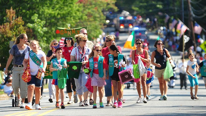 Mendham Girl Scouts march in the parade. Mendham celebrates Labor Day with its annual parade.