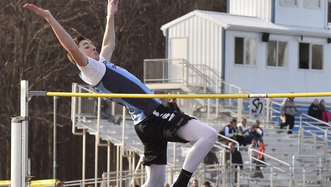Southern Door's Sam Gerend tries to clear the bar in the boys high jump during a Packerland Conference quadrangular meet Tuesday at Southern Door. Gerend won the event at 5 feet, 4 inches.