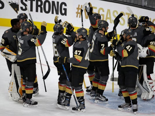 Vegas Golden Knights celebrate after defeating the Arizona Coyotes during in an NHL hockey game Tuesday, Oct. 10, 2017, in Las Vegas. The Golden Knights won, 5-2. (AP Photo/John Locher)
