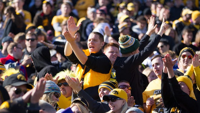 Iowa fans cheer during a NCAA Division I Football game between Northwestern University and the University of Iowa at Ryan Field on October 17, 2015 in Evanston, Illinois.