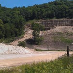Dust from a blasting operation at Pattison Sand's surface mine in Iowa is seen from across the Mississippi River in Bagley, Wis. Homeowners Jim and Kathy Kachel say that dust from the mine has gotten inside of their home.