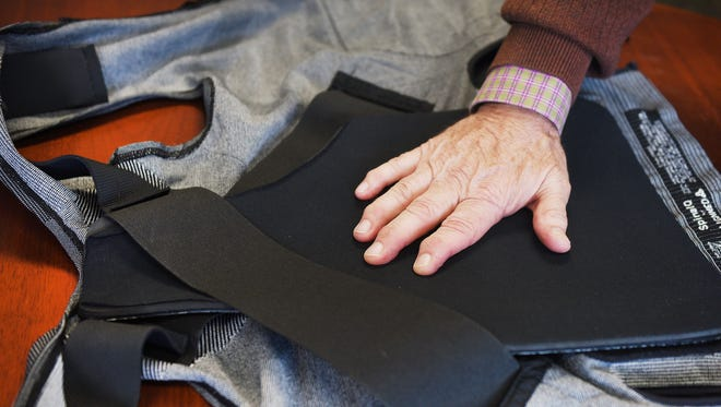 Ted Thoms demonstrates how his back brace helps his shoulder and back discomfort Wednesday, April 11, at the Argus Leader newsroom in Sioux Falls.