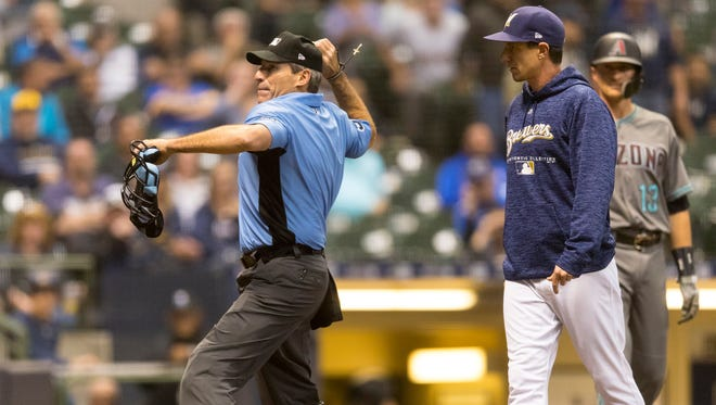 Angel Hernandez ejects Milwaukee Brewers manager Craig Counsell during the ninth inning.