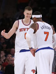 The Knicks' Kristaps Porzingis celebrates with teammate Carmelo Anthony after scoring against the Chicago Bulls during the fourth quarter of Saturday night's game in New York.