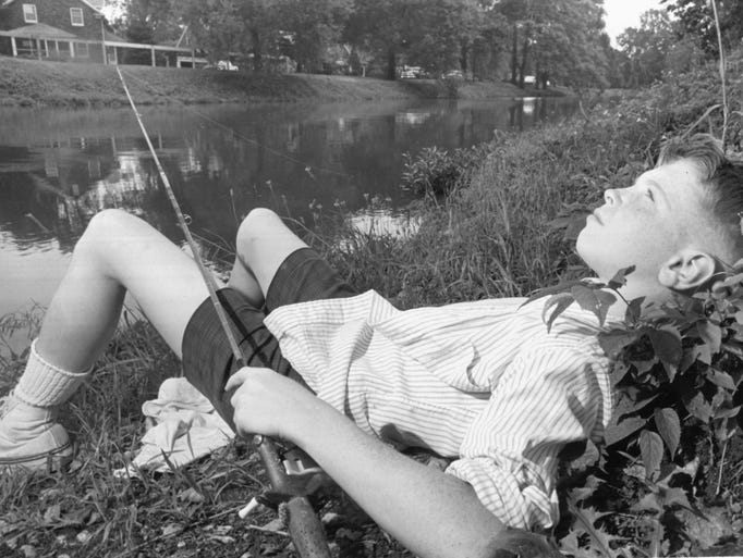 12 year old John MeHaffey enjoyed the first day of summer on June 21, 1964 fishing on the banks of the Indianapolis Water Company canal near Washington Boulevard.