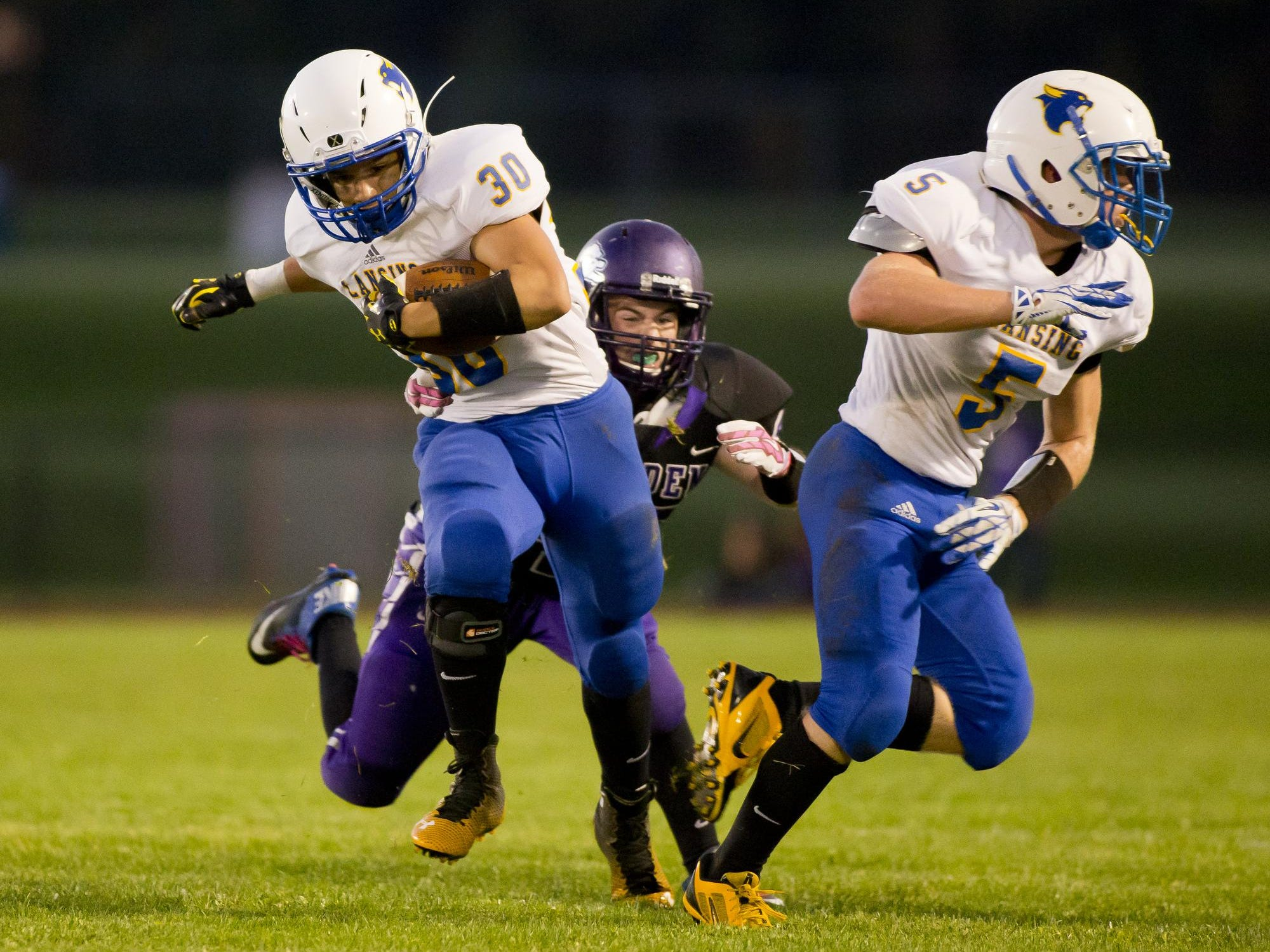 """Lansing's Tim Kelley, left, shown in action last season against Dryden, rushed for more than 1,000 yards as a sophomore. Bobcats coach John Winslow said the 5-9, 180-pound Kelley will be """"the best football player ever to graduate from Lansing High School."""""""