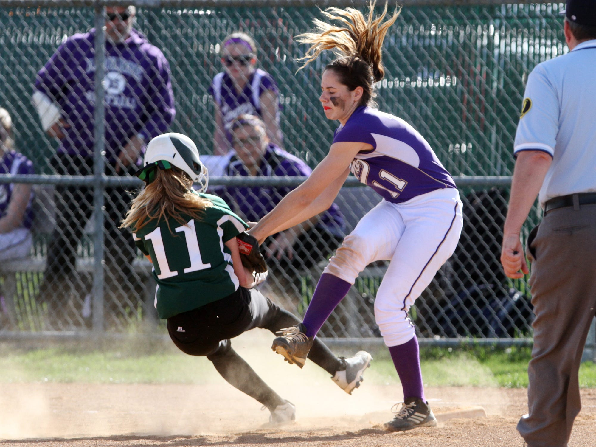 South Plainfield's Caity Hughes is tagged out by Monroe third baseman Cindy Foresta, Wednesday, April 15, 2015, in South Plainfield, NJ.