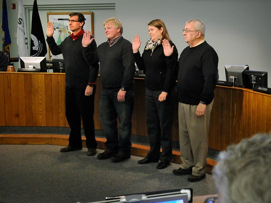 St. Cloud City Council members Jeff Johnson, Dave Masters, Nancy Gohman and John Libert are sworn in during a meeting in January 2015.