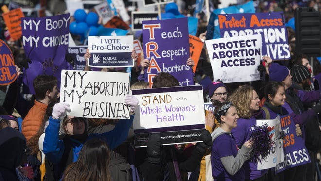 Supporters of legal access to abortion, as well as anti-abortion activists, rally outside the Supreme Court in Washington, DC, March 2, 2016, as the Court hears oral arguments in the case of Whole Woman's Health v. Hellerstedt, which deals with access to abortion. The US Supreme Court on March 2 took up its most important abortion case in a generation, the outcome of which could impact the ability of millions of women to end an unwanted pregnancy -- as well as the White House race. With the court now split evenly between liberals and conservatives following the death of Antonin Scalia, all eyes are on Justice Anthony Kennedy, who wields a swing vote on the issue, one of the most divisive in the world of US politics.
