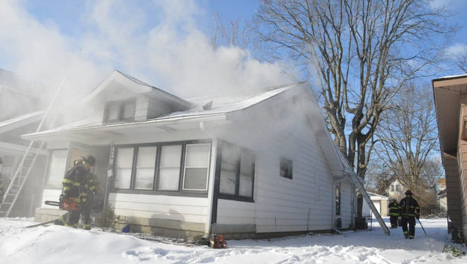 Indianapolis firefighters responded to a fatal fire at 428. S. Oakland Ave. the morning of Thursday, Jan. 23, 2014.