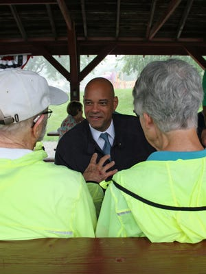 Desmund Adams, who's vying for the Democratic ticket to take on David Young in for Iowa's 3rd Congressional seat, talks to voters at a picnic with Warren County Democrats.