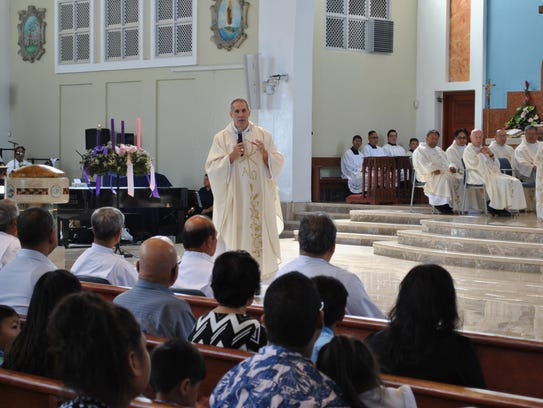 Archbishop Michael Byrnes delivers the homily at Saturday's