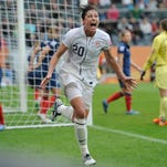 Abby Wambach celebrates after scoring for Team USA against France in the 2011 Women's World Cup.