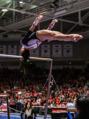 Southern Utah's Kirsten Yee competes in the uneven bars during a meet against Utah State.
