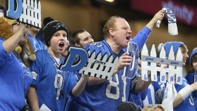 Lions fans celebrate a defensive stop against the Packers in the second quarter Sunday, Jan. 1, 2017 at Ford Field.
