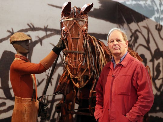 Author/playwright Michael Morpurgo poses at opening