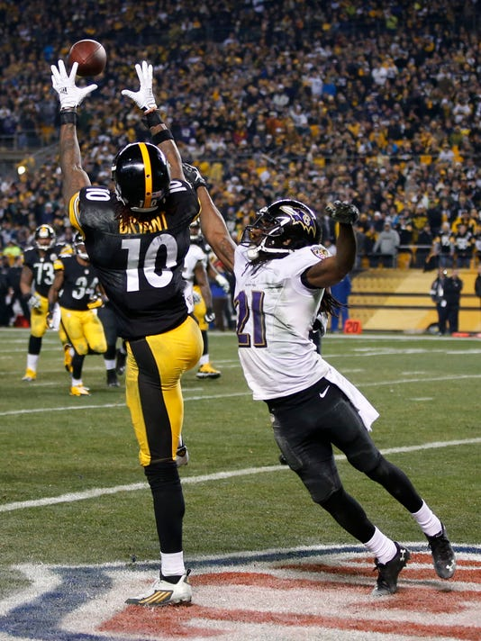 Pittsburgh Steelers wide receiver Martavis Bryant (10) makes a touchdown catch past Baltimore Ravens cornerback Lardarius Webb (21) in the fourth quarter of an NFL wildcard playoff football game, Saturday, Jan. 3, 2015, in Pittsburgh. Brown was ruled down short of the goal line. (AP Photo/Gene Puskar)