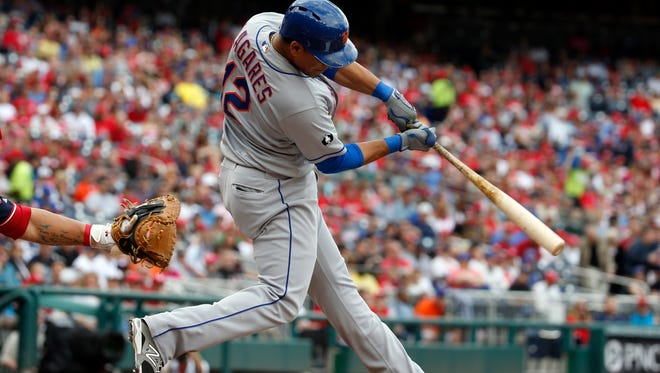 Mets center fielder Juan Lagares hits an RBI single during the first inning at Nationals Park on Saturday.