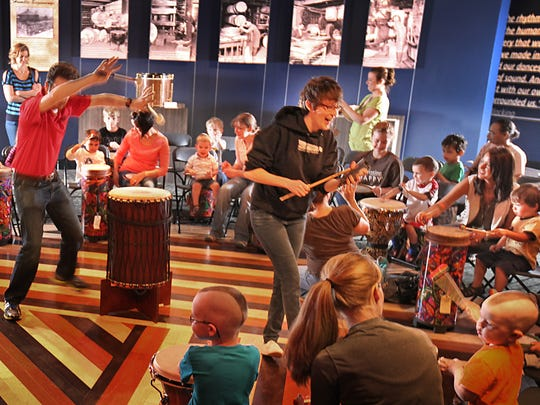 Visitors to the Rhythm!  Discovery Center, 110 W. Washington St., in Indianapolis are encouraged to beat on drums within the exhibit hall, where the Leddy drums are displayed.