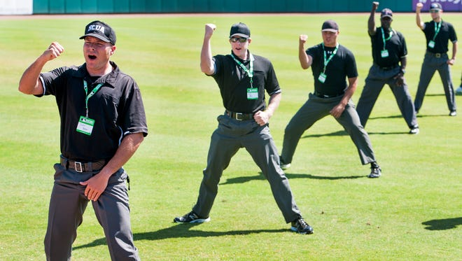 Camp participants, including Justin Beam, left, practice calling strikes as the Major League Baseball Umpire Camp makes a stop at Riverwalk Stadium in Montgomery, Ala., on Saturday May 14, 2016.