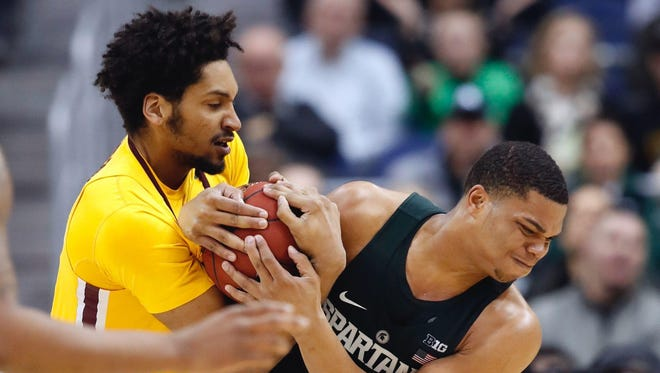 Minnesota forward Jordan Murphy, left, and Michigan State guard Miles Bridges wrestle for the ball during the second half MSU's 63-58 loss in the Big Ten tournament Friday in Washington.