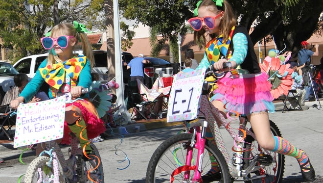 Among this weekend's family-friendly events is the Edison Festival of Light Junior Parade in downtown Fort Myers. In this file photo, Heidi Kinsey, left, and Peyton Harris, cruise down Second Street.