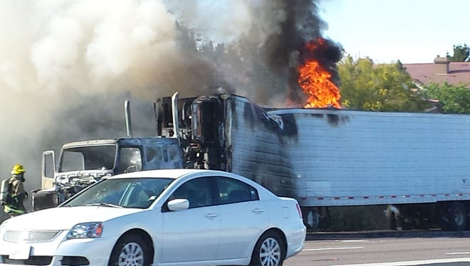 The three right eastbound lanes on Interstate 10 at Elliot Road were blocked for over an hour Saturday as fire crews worked to extinguish a fire that engulfed a semitruck, authorities said.