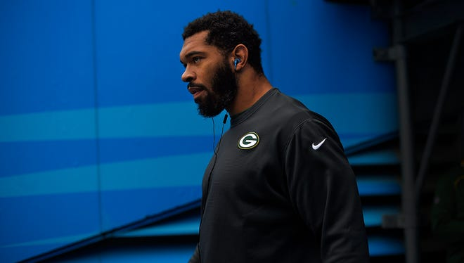 Green Bay Packers linebacker Julius Peppers walks onto the field to warm-up before the game against the Carolina Panthers at Bank of America Stadium in Charlotte, N.C.