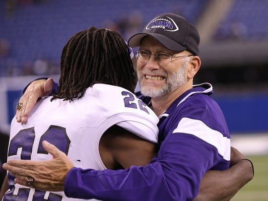 Ben Davis head Mike Kirschner, right, celebrates their 6A title win with LB Asmar Bilal.
