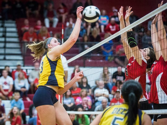 FILE -- Delta's Molly Hunt hits against Wapahani during their game at Wapahani High School Thursday, Sept. 29, 2016.