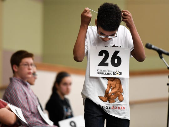William Sandage, from North Junior High School, takes his number off after missing a word in the Tri State Spelling Bee held at the Ivy Tech Auditorium Saturday, March 4, 2017.