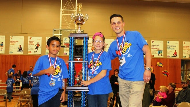2017 Champions of SPELL for Great Futures pictured from left are: Luis Ruiz, fourth-grader at Parkside Elementary; Kaitlyn Ziegler, seventh-grader at Theisen Middle School; and Jacob Huempfner of ACH Foam Technologies.