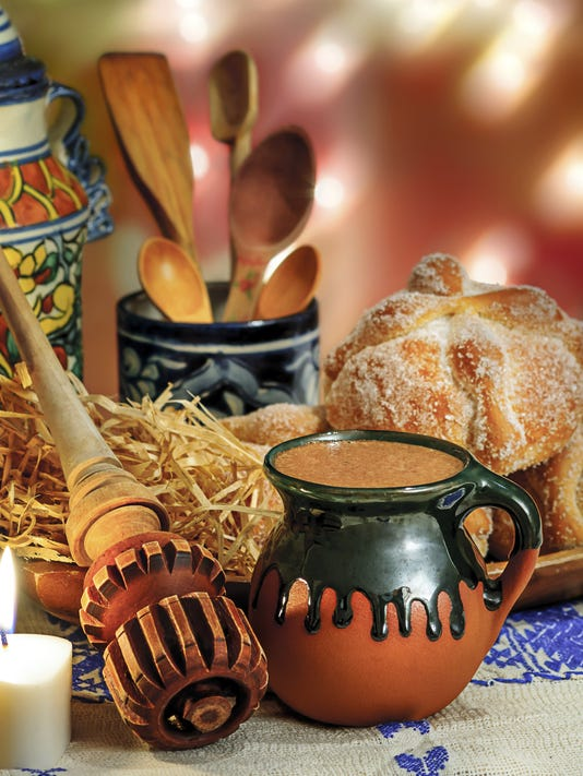 Hot chocolate and sweet bread pan de muerto.