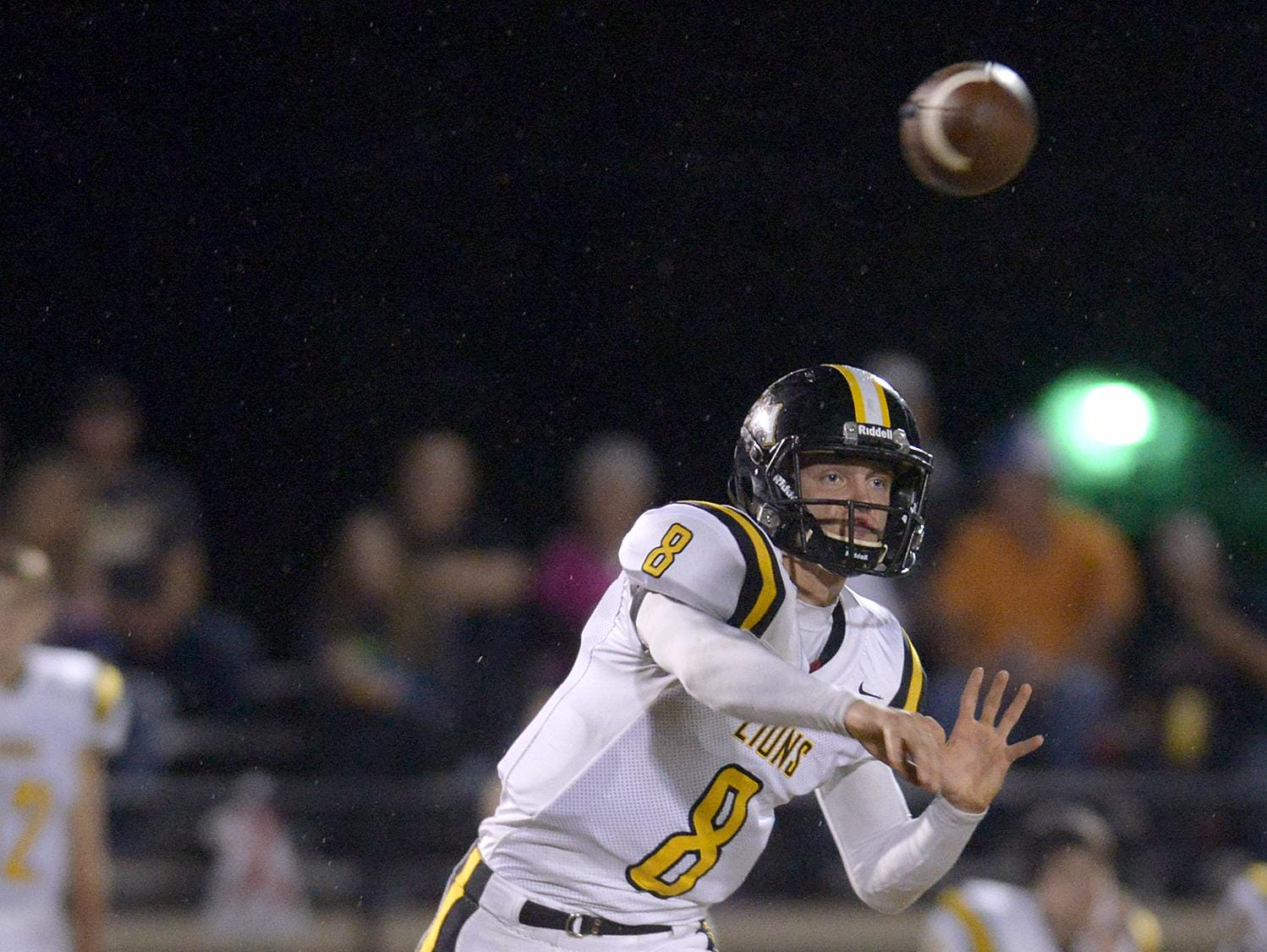 Scotts Hill's Junior Kimmel (8) throws a pass against Trinity Christian Academy at TCA.