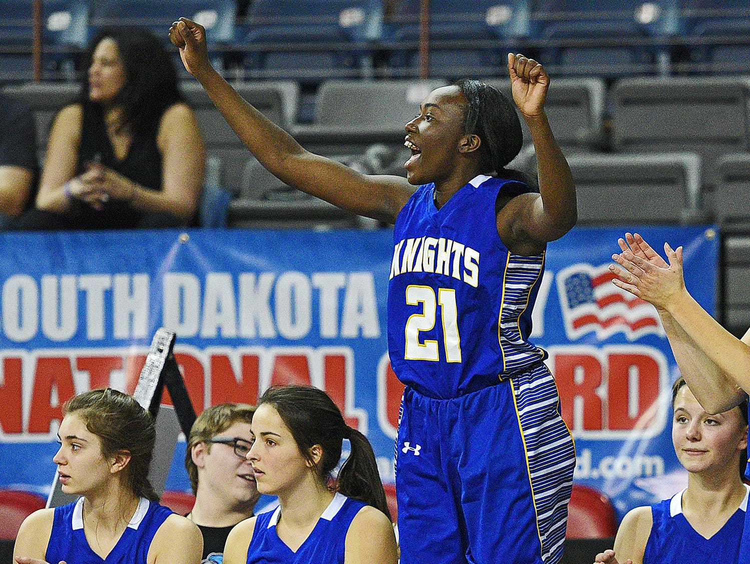 O'Gorman's Nyanwel Arop (21) reacts from the bench after a teammate scored during a 2017 SDHSAA Class AA State Girls Basketball quarterfinal game against Roosevelt Thursday, March 16, 2017, at Rushmore Plaza Civic Center in Rapid City. O'Gorman beat Roosevelt 37-33.