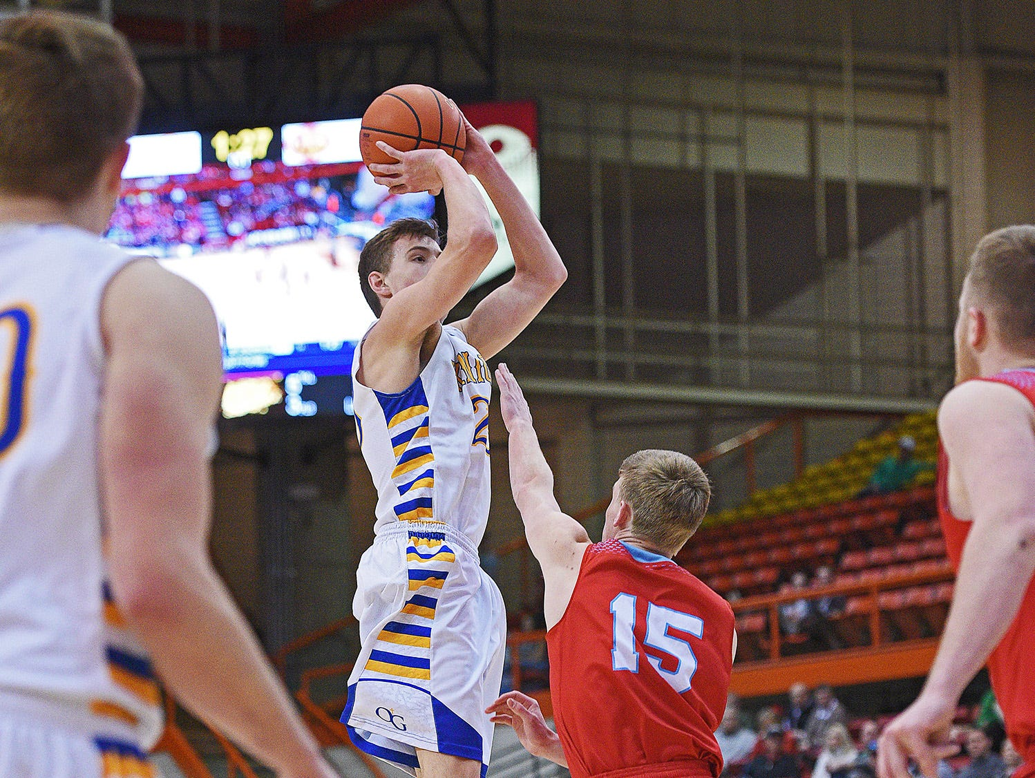 O'Gorman's Matt Cartwright (23) goes up for a shot over Lincoln's Alex Glanzer (15) during a 2017 SDHSAA Class AA State Boys Basketball semifinal game Friday, March 17, 2017, at Rushmore Plaza Civic Center in Rapid City.